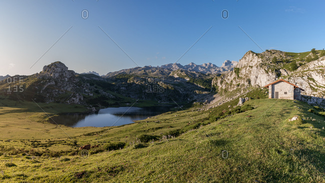 Majestic view of small calm lake near magnificent mountains on beautiful sunny day