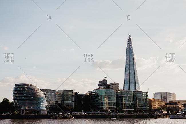 July 15, 2018: Vessel on river near modern city