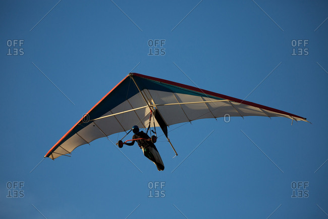 Anonymous person flying on hand glider
