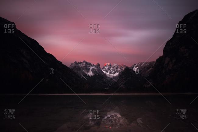 Sunrise at autumn mountain lake. Lago di Landro, Dolomites Alps, Italy
