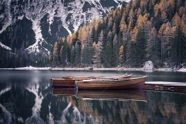 Wooden boats at the alpine mountain lake. Lago di Braies, Dolomites Alps, Italy