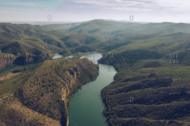 Magnificent drone view of wonderful wetland and hilly terrain on sunny day in Cuenca, Spain