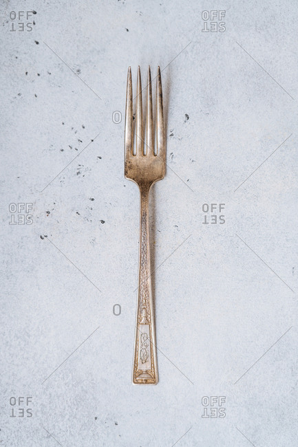 One vintage fork on a speckled kitchen counter