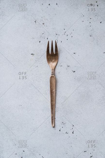 Vintage metal fork on a speckled counter top
