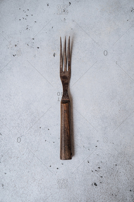 Vintage fork on a speckled background