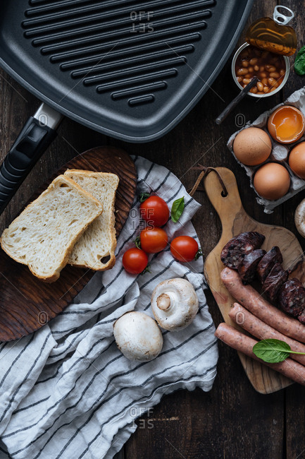 Overhead view of ingredients for a full English breakfast