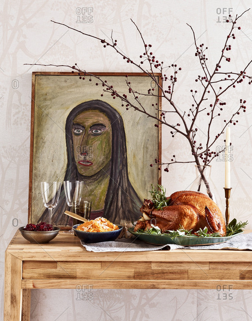 July 19, 2016: Artwork on table with Thanksgiving dinner served