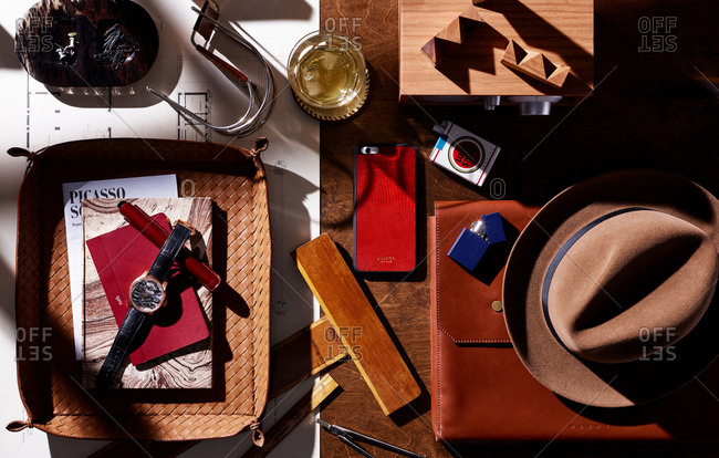 January 11, 2016: Overhead view of a cluttered desk with cell phone, cigarettes, watch, and other items