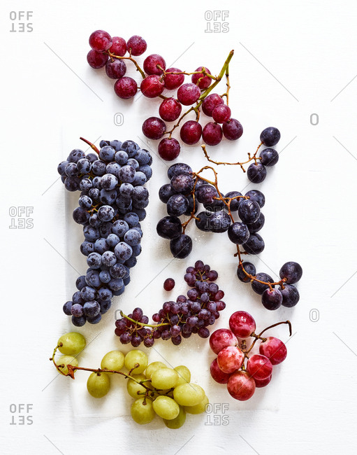Variety of grapes on white background
