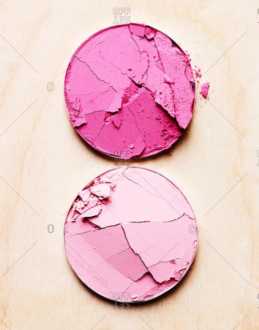 Pink shades of cracked powder makeup