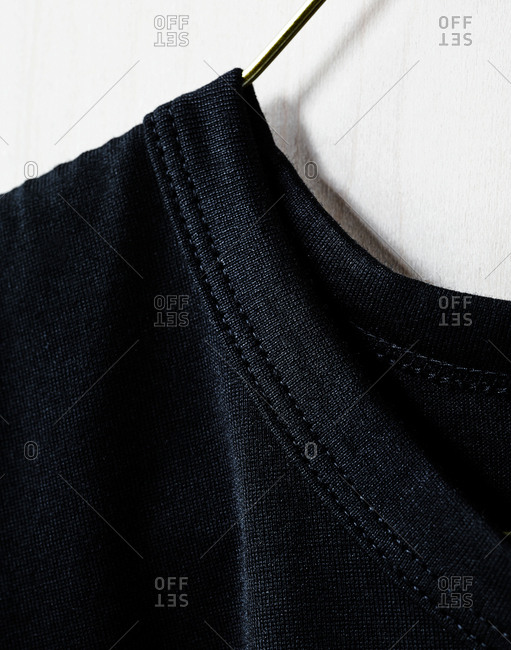 Close up of the collar of a black t-shirt