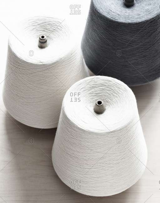 White ad gray thread spools