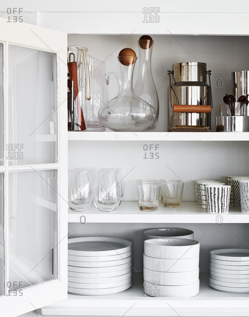 Kitchen cupboard full of dishes