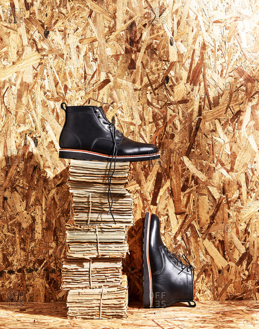Black leather boots on wood background