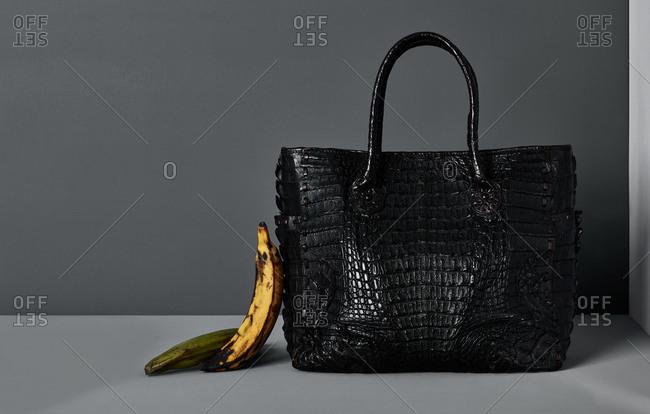 Alligator skin bag and bananas