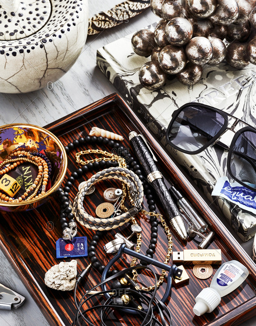 December 13, 2016: Overhead view of a cluttered desk with jewelry, sunglasses, and other items