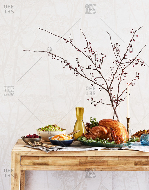 Thanksgiving dinner served on wooden table