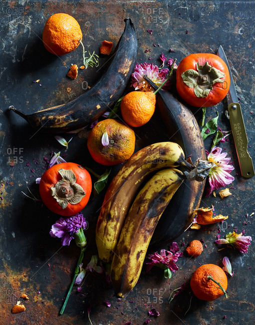 December 11, 2018: Fruit and flowers on rustic background