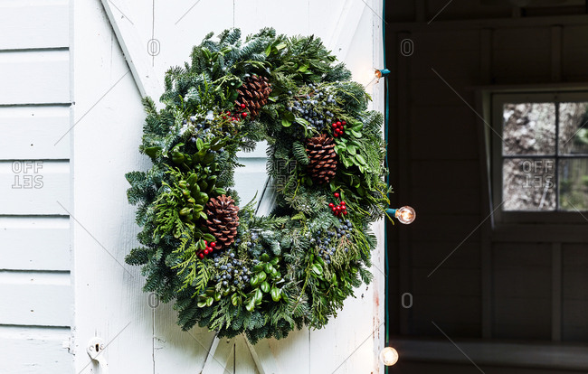 Holiday wreath on white door