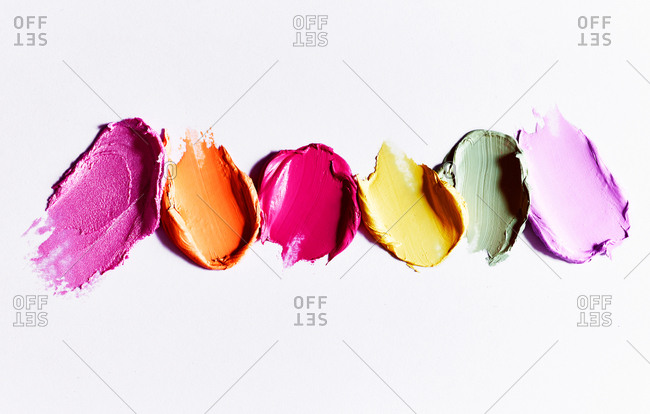 Colorful lipsticks smears on white background