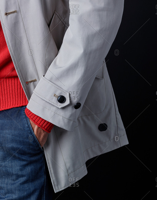 Man wearing stylish clothing with his hand in his pocket