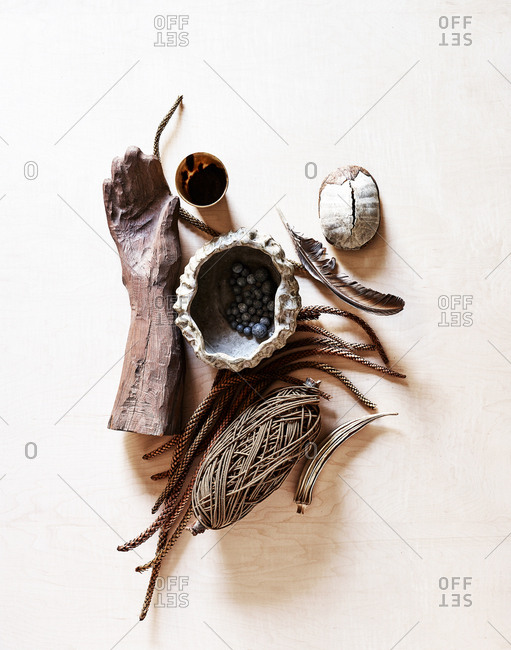Still life of carved hand and various objects