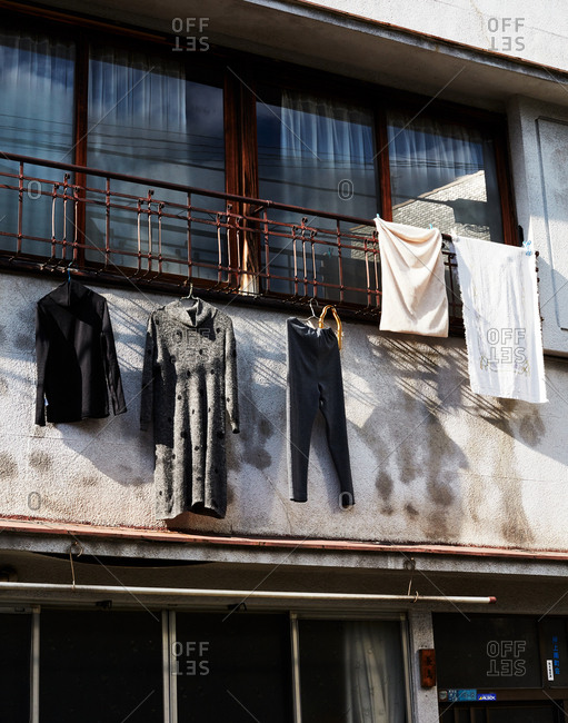 Tokyo, Japan - November 19, 2018: Clothing hanging from balcony