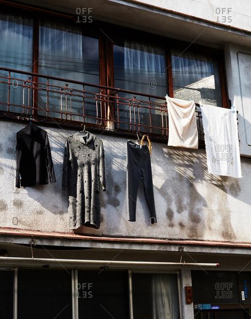 Tokyo, Japan - November 19, 2018: Clothing hanging from balcony