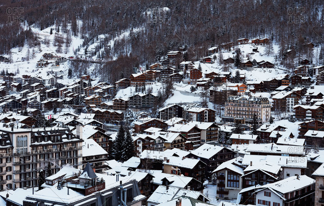 Zermatt, Switzerland - January 16, 2017: View over snow-covered rooftops