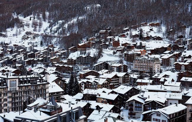 Zermatt, Switzerland - January 16, 2017: View over snow-covered rooftops