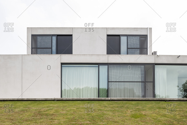 Concrete exterior of a modern house with large windows