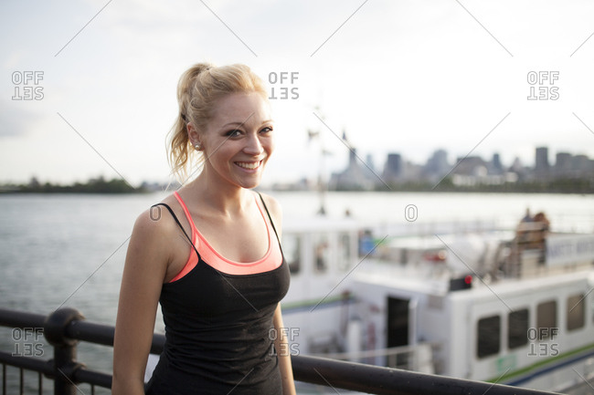 Portrait of woman working out on shore