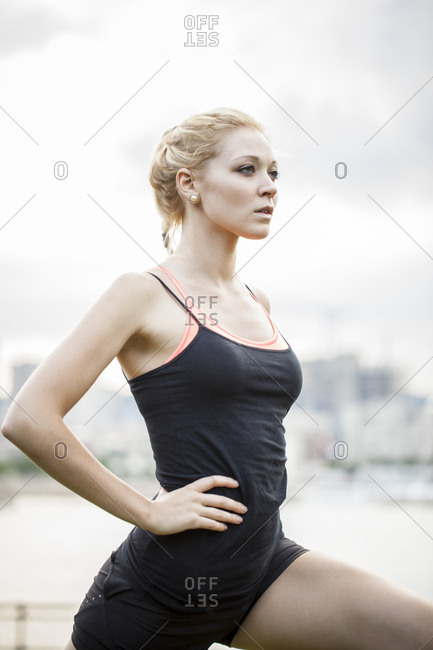 Portrait of young woman doing yoga working out in park