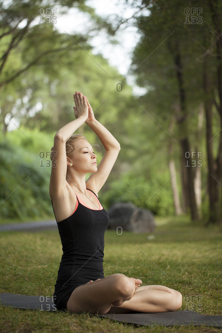 Young woman doing yoga working out