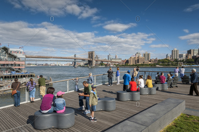 September 22, 2013: USA, New York, New York City, Manhattan . Pier 15, a two-level, reconstructed waterfront pier opened to the public in late Fall 2011. The Pier offers expansive views of the East River and Manhattan and Brooklyn skylines. Pier 15 features an elevated lawn area, chaise lounge seating, and two separate look-outs.
