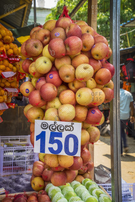 October 25, 2017: Sri Lanka, Colombo . fruit seller showing his apples at the market of Pettah Bazaar, a crowded, large colombo market that occupies a vast neighborhood near the port