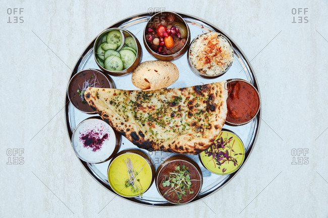 Indian appetizer with flatbread and various dipping sauces