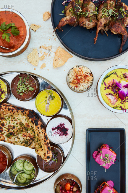 Indian dishes served on light background
