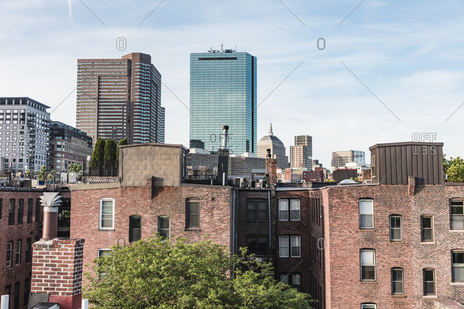 Several brick and glass modern buildings in the Boston, Massachusetts skyline