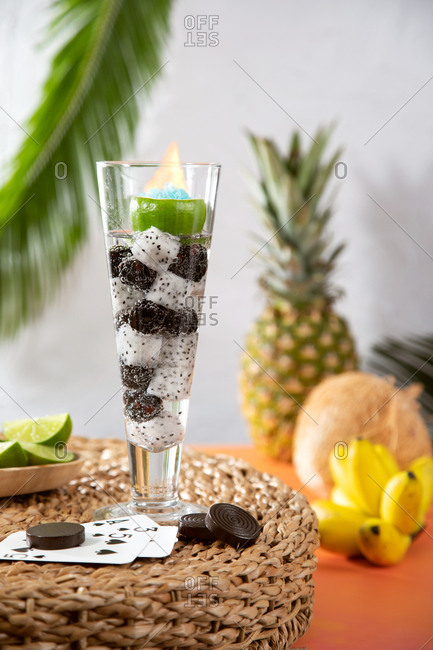 Flaming tropical cocktail with fruit