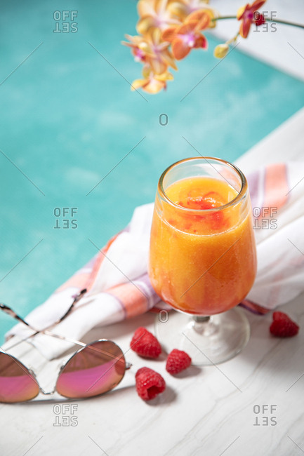 Tropical orange cocktail poolside