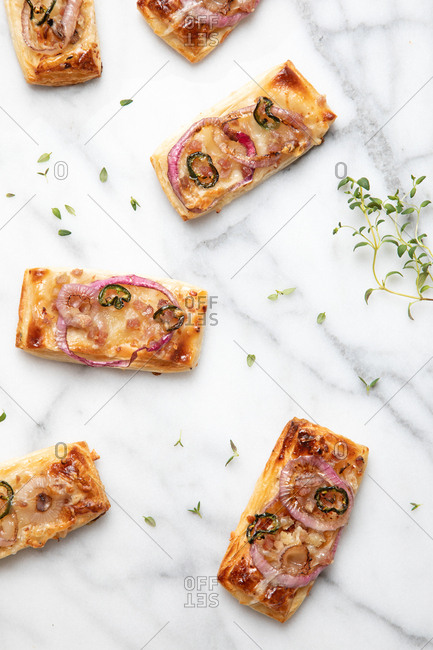 Slices of pizza with cheese on onions