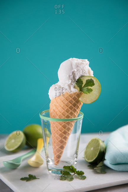 Ice cream cone with lime and cilantro in a cone
