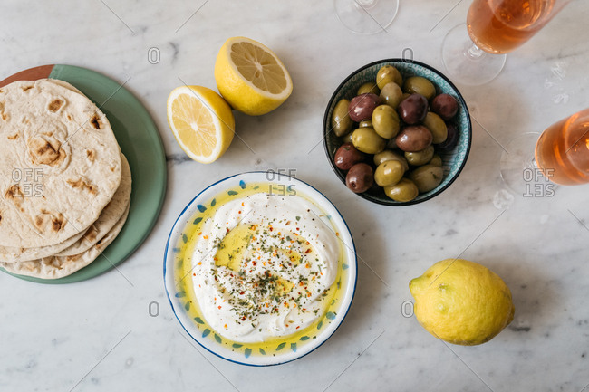 Greek yogurt served with flatbread, olives, and champagne