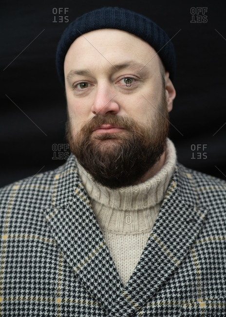 Portrait of a bearded man wearing a wool jacket and a turtleneck sweater