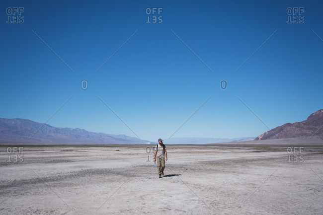 USA- California- Death Valley- man walking in desert