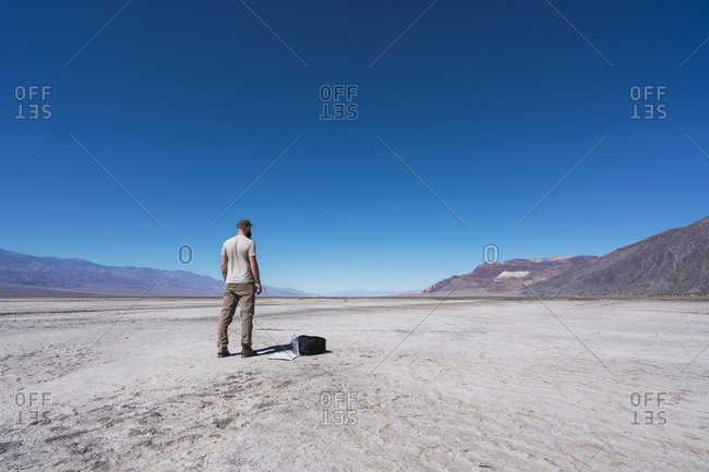 USA- California- Death Valley- back view of man standing in the desert