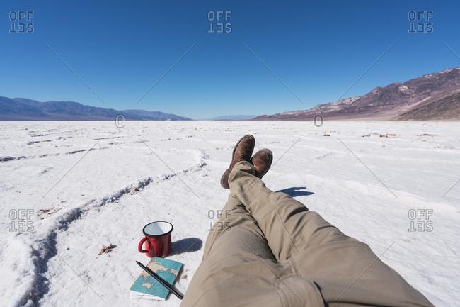 USA- California- Death Valley- legs of man having a break