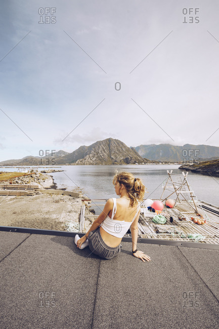 Norway- Lofoten- back view of woman looking at distance