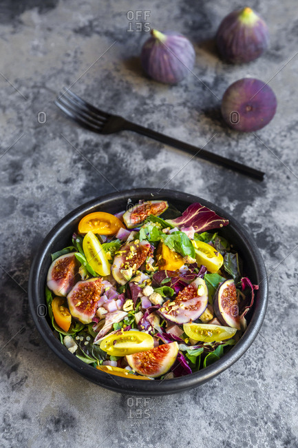 Mixed salad with fig- tomato- ham- cheese- pistachio